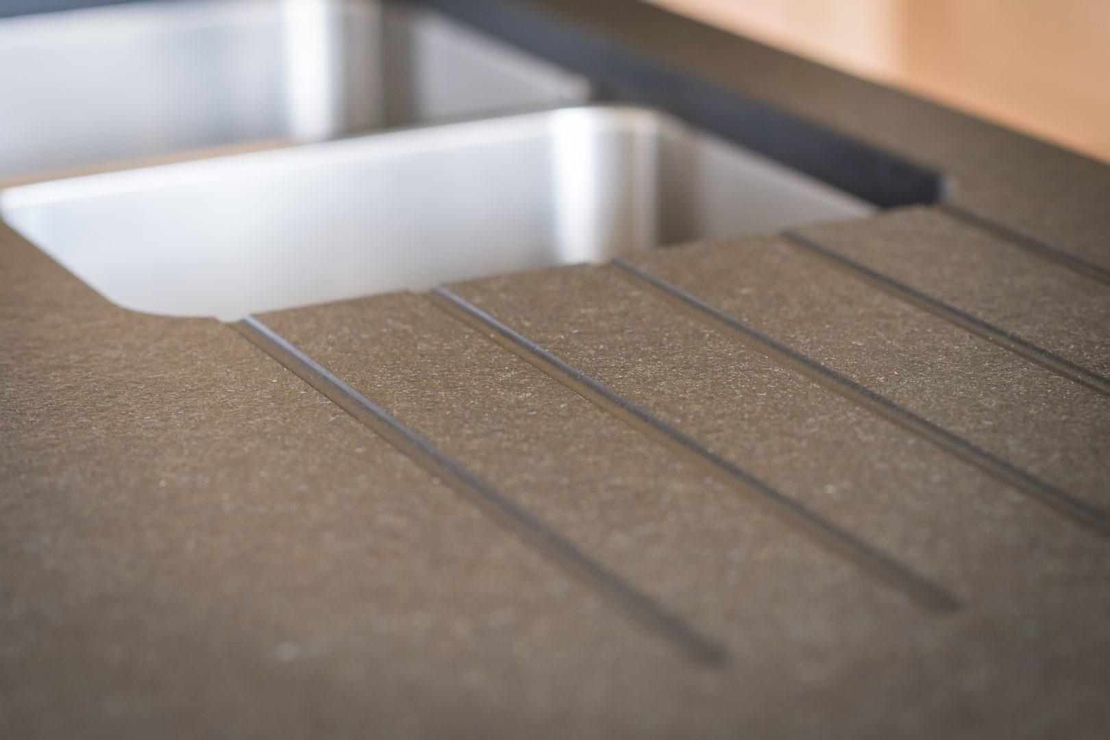 Detail van spoelbak in composiet - ACK Keukens